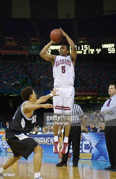 Earnest Shelton of University of Alabama Crimson Tide shoots against the Vanderbilt University Commodores during the SEC Men's Basketball Tournament...