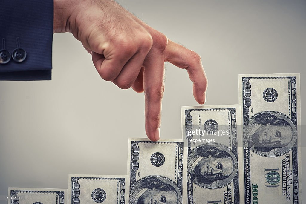 Earning wealth one step at a time : Stock Photo