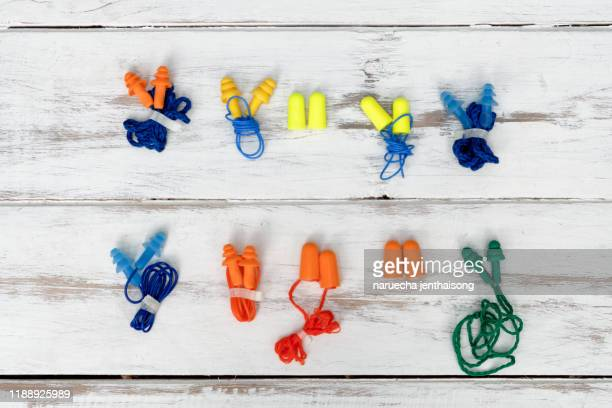 earplugs isolated on white background - hearing protection stock pictures, royalty-free photos & images