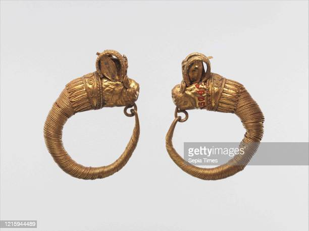 Earrings with lion-griffin terminal, Ptolemaic Period, 4th-3rd century BC, From Egypt, Gold, a. As Worn: H. 2.3 _ W. 2.7 cm , Hoops formed of wound...