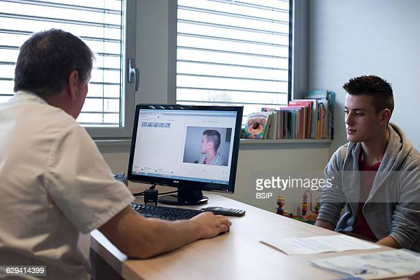 Ears Nose Throat Head and Neck surgery specialist LyonNord Rillieux polyclinic Consultation before surgery with a young man who has breathing...