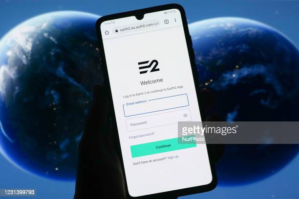 Earth 2 log in website is displayed on a mobile phone screen with Earth 2 website's background photographed on this illustration photo taken in...