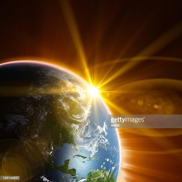 Terre et le soleil levant