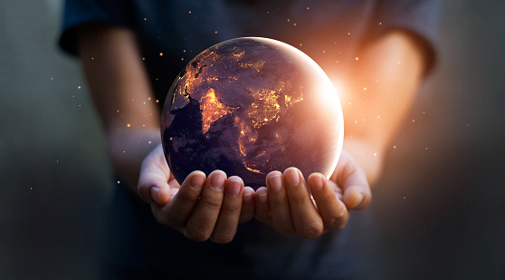 Earth at night was holding in human hands. Earth day. Energy saving concept, Elements of this image furnished by NASA 944453634