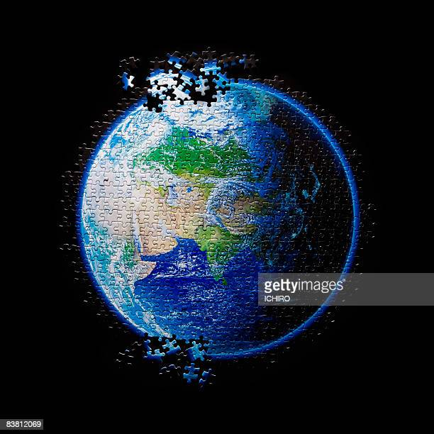 earth consists of puzzle. - concepts & topics stock pictures, royalty-free photos & images