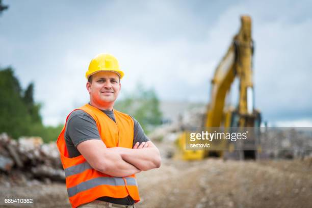 Earth Digger Driver at construction site