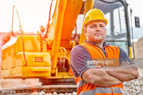 earth digger driver - excavator stock photos and pictures