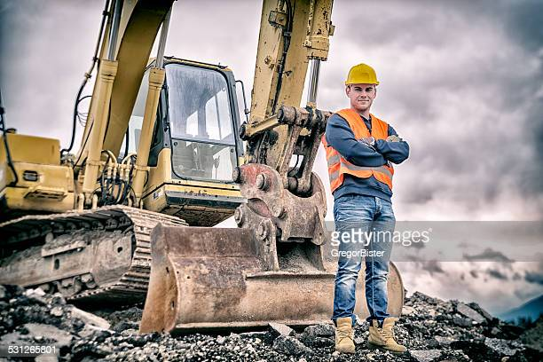 earth digger driver - construction worker stock pictures, royalty-free photos & images