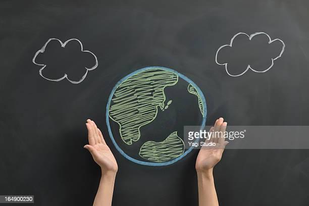 earth drawn on a blackboard - solo una donna giovane foto e immagini stock