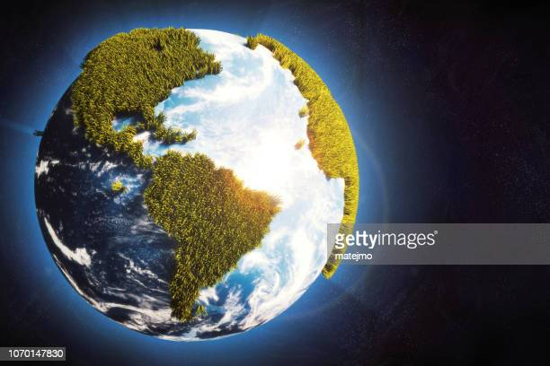 earth globe in space with cartoony grass continents & glowing atmosphere - europa continente foto e immagini stock