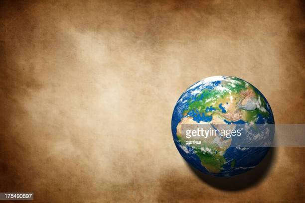 Terre globe sur vieux papier texture d'arrière-plan