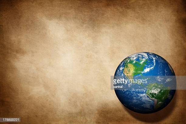 Earth globe on aged paper texture background