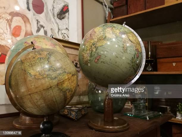 Earth globes for sale in an antique shop in El Rasto in Madrid Spain