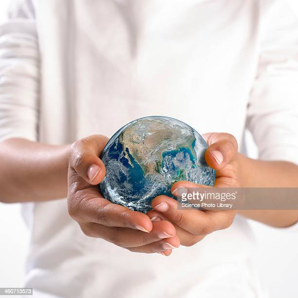 earth held in child's hands - world kindness day fotografías e imágenes de stock