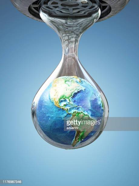 earth inside the dripping water drop - rescue stock pictures, royalty-free photos & images