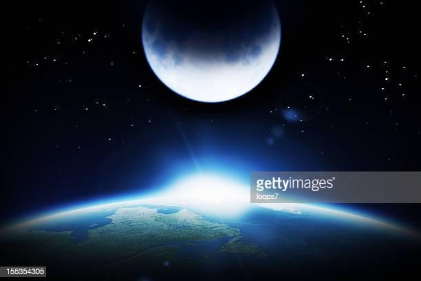 Terre, lune et soleil levant