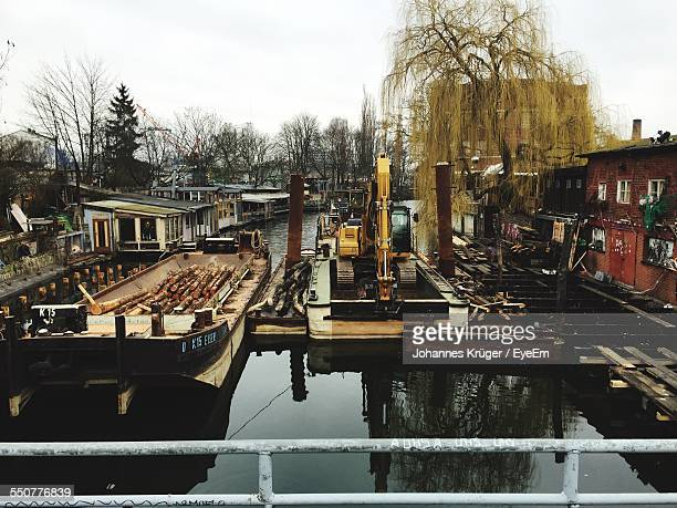 Earth Mover And Logs On Floating Platform In Canal