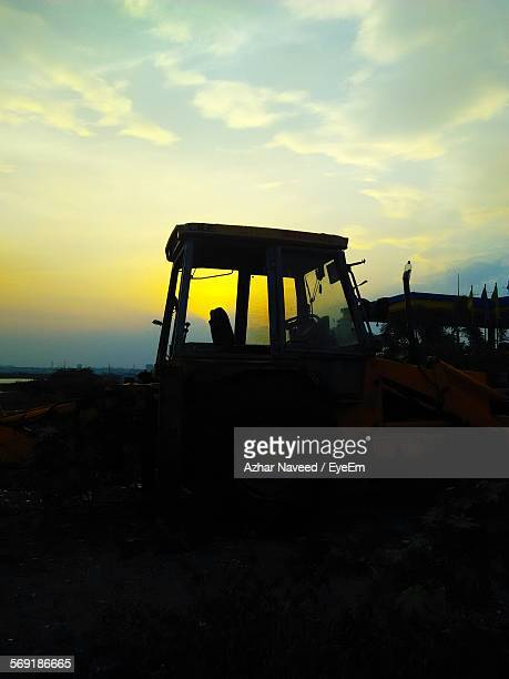 Earth mover at construction site during sunset