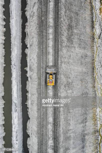 earth mover in a mine photographed from above, florida, united states of america - isolated color stock pictures, royalty-free photos & images