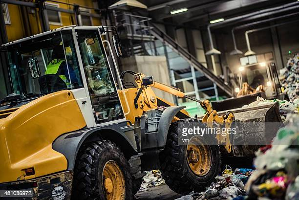 Earth mover in the garbage dump