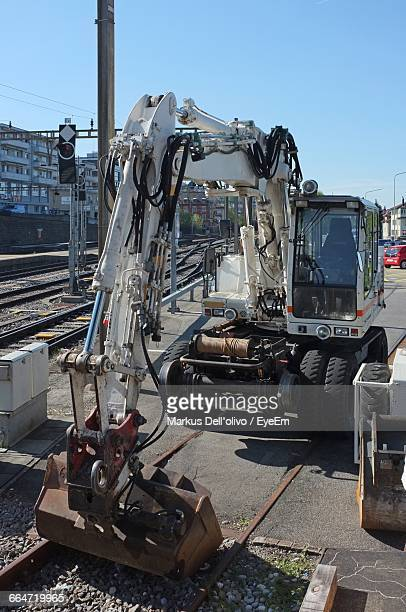 Earth Mover On Railroad Track Against Clear Sky