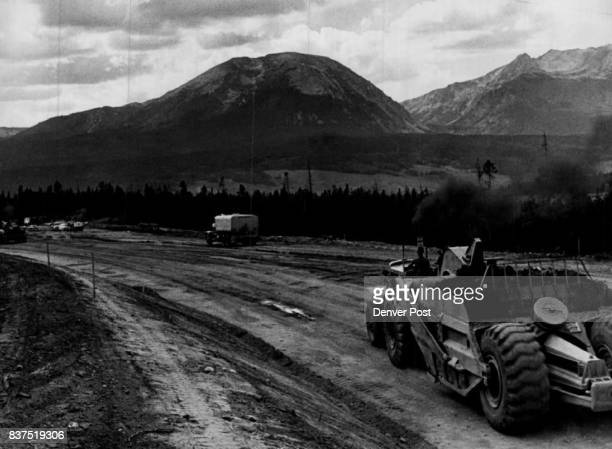 Earth moving machine works on new route for US Highway 6 The highway which now runs through present town of Dillon must be rerouted above reservoir...