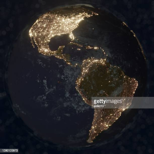 earth night space with some clouds city lights bokeh, america - the americas stock pictures, royalty-free photos & images