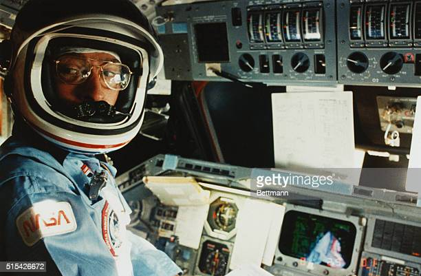 Earth Orbit Commander John W Young of the Space Shuttle mission STS9 is at the commander's station ready for the reentry of the Space Shuttle Columbia