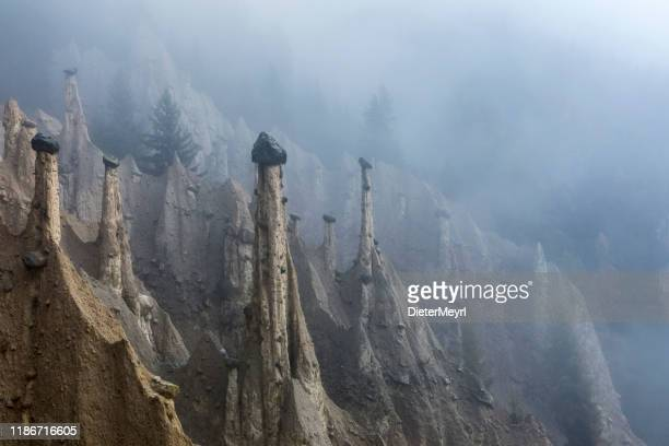 earth pyramids in south tyrol, platten, italy - rock hoodoo stock pictures, royalty-free photos & images