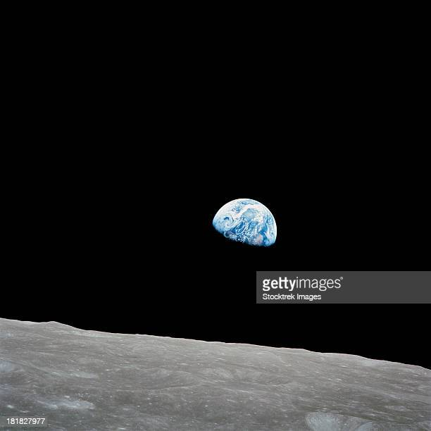 earth rising above the lunar horizon. - apollo 8 stock pictures, royalty-free photos & images