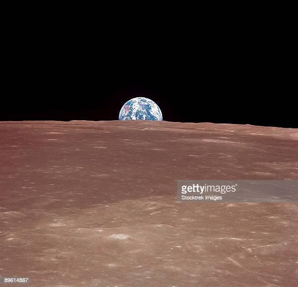 Earth rising above the Moon's horizon.