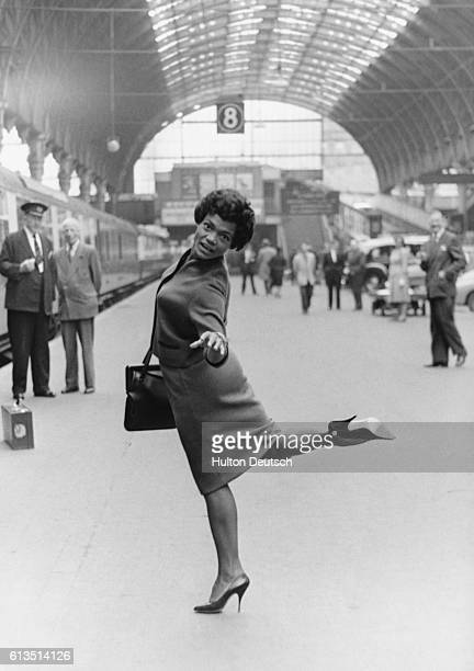 Eartha Kitt arrives in London with her husband of three months American singer actress and dancer Eartha Kitt arriving at Paddington Station London...