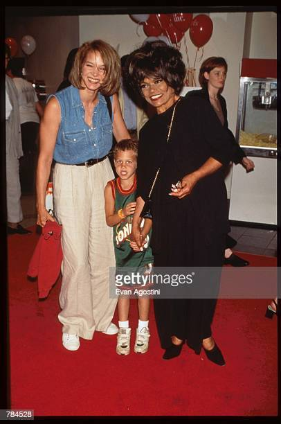 Eartha Kitt stands with her daughter and grandson at the premiere of Harriet the Spy July 9 1996 in New York City The film is based on the...