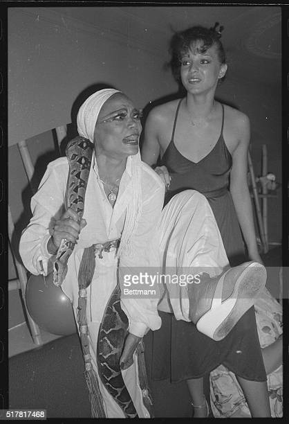 Eartha Kitt star of Broadway's Timbuktuis all wrapped up in her gifta 4 1/2 foot boa constrictor after it was presented to her as a gift by an...