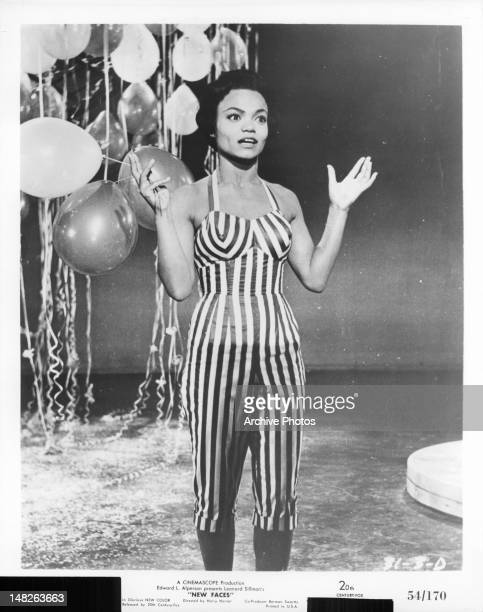 Eartha Kitt with balloons in a scene from the film 'New Faces' 1954
