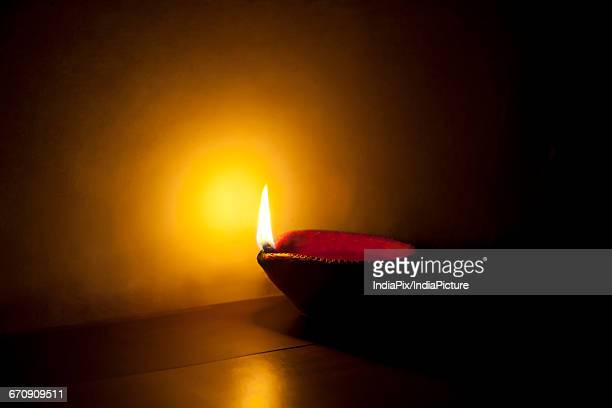 earthen lamp lit for festival - diya oil lamp stock pictures, royalty-free photos & images