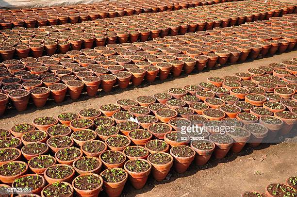 Earthen pots for plants waiting to be sold at a Local nursury in Islamabad Pakistan