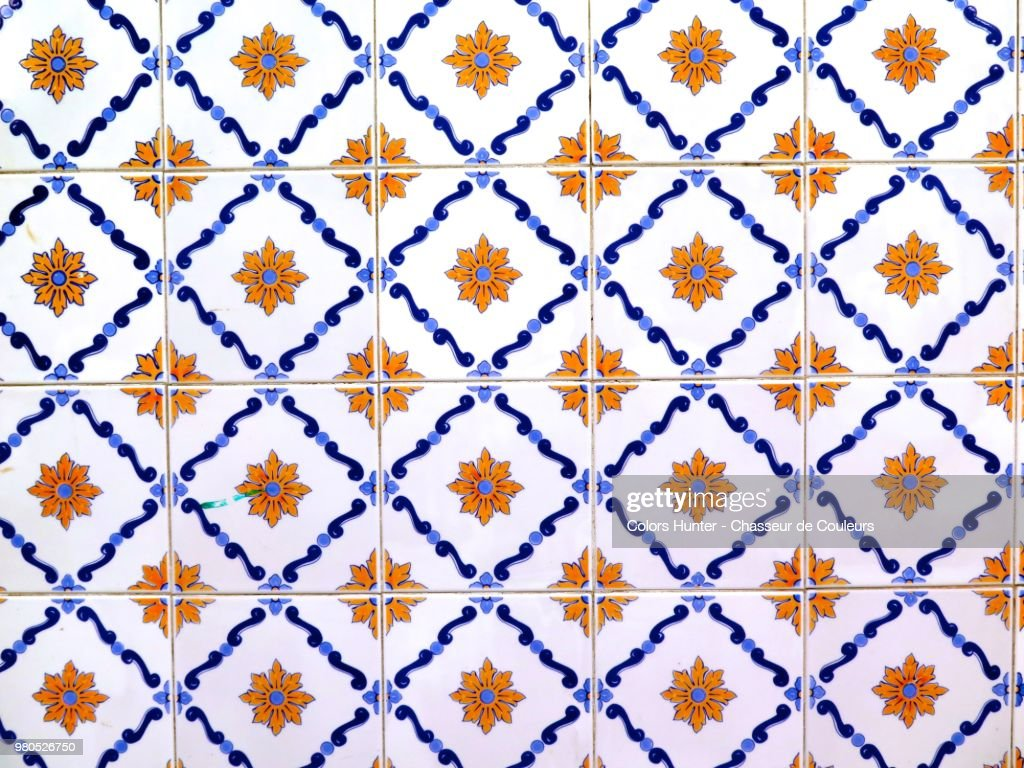 Earthenware decorated on a wall in Portugal : Stock Photo