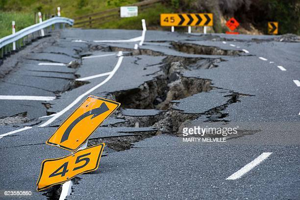TOPSHOT Earthquake damage to State Highway 1 is seen south of Kaikoura on November 16 2016 Rescue efforts after a devastating earthquake in New...