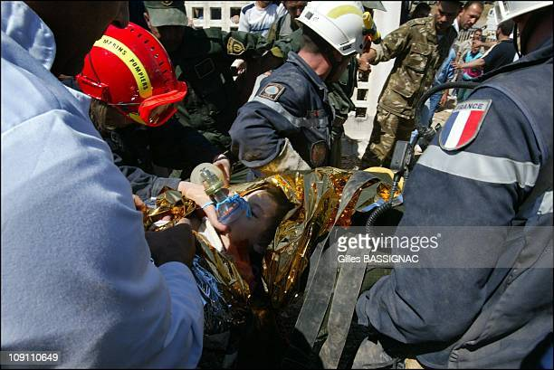 Earthquake In Boumerdes Civil Security Services Saves 2YearOld Girl From The Rubble Of A Collapsed Building On May 23 2002 In Boumerdes Algeria A...
