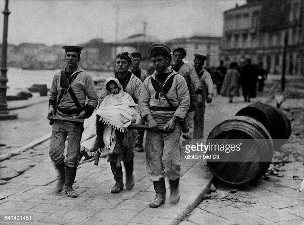 Earthquake Messina 28Dec 1908British sailors helping to save injured persons