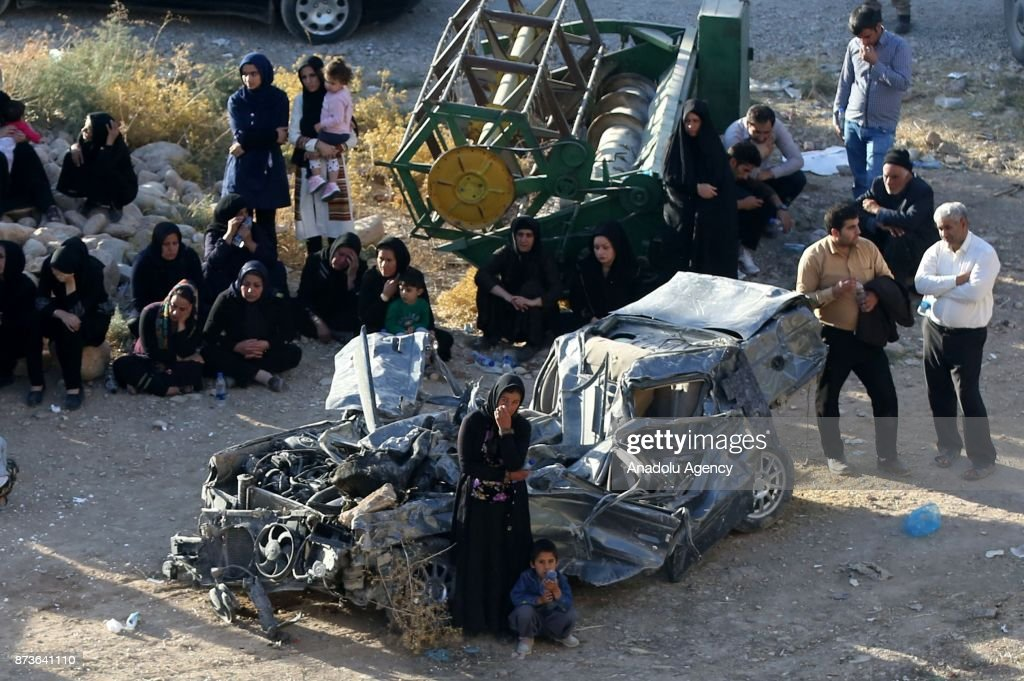 Earthquake survivors are seen as they gather, at Sarpol-e Zahab province of Kermanshah, Iran on November 13, 2017 following a 7.3 magnitude earthquake that hit the Iraq and Iran. An earthquake measuring 7.3 on the Richter scale rocked northern Iraq and Iran, the U.S. Geological Survey said on Sunday evening. At least 341 died and 5,953 others were injured in Iran's bordering regions, especially in Kermanshah province in west.