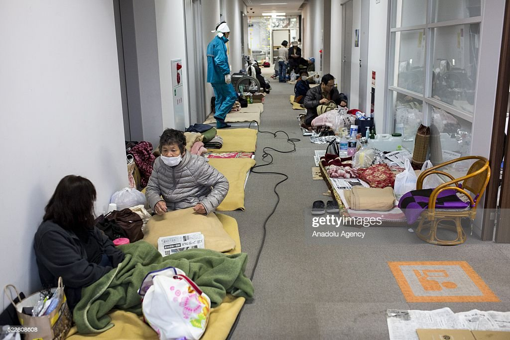 Earthquake survivors are seen on hallway of Mashiki Gymnasium Evacuation Center in Kumamoto, Japan on April 21, 2016 . To date 45 people are confirmed dead and around 11,000 people have evacuated after an 6.5 earthquake on Thursday night and a stronger 7.3 quake on Saturday morning struck the Kyushu Island in Western Japan.
