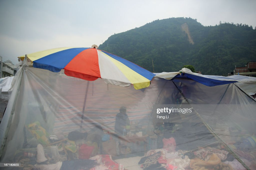 Earthquake survivors live in the tents on April 22, 2013 in Baoxing county of Ya An, China. A magnitude 7 earthquake hit China's Sichuan province on April 20 claiming over 190 lives and injuring thousands.
