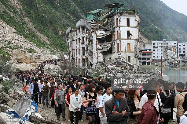 Earthquake survivors mourn relatives on May 12 an year anniversary of the Sichuan Earthquake in the devastated town of Beichuan Sichuan China