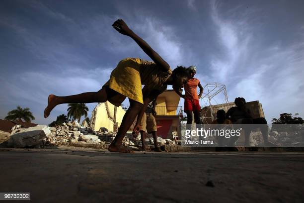 Earthquake survivors play hopscotch in front of destroyed buildings February 15 2010 in Leogane Haiti Leogane is located near the epicenter of the...