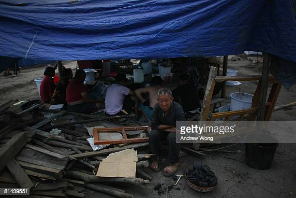 Earthquake survivors rest at a refugee camp on June 5, 2008 in Shifang, Sichuan province, China. More than 69,000 people are now known to have died...