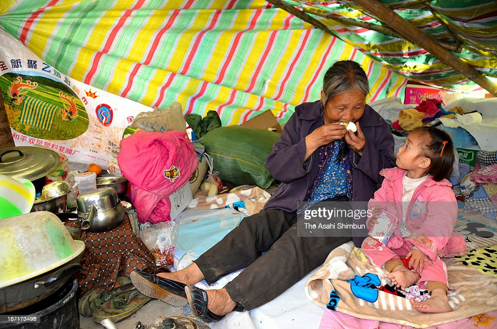 YA'AN, CHINA - APRIL 22: (CHINA OUT, SOUTH KOREA OUT) Earthquake survivors rest at a tent on April 22, 2013 in Lushan of Ya'an, China. A magnitude 7 earthquake hit China's Sichuan province on April 20 claiming over 160 lives and injuring thousands.