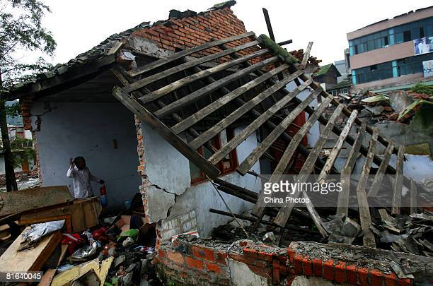 Earthquake survivors salvages what they can from the debris of their destroyed homes at the Yinghua Township on June 19, 2008 in Shifang of Sichuan...