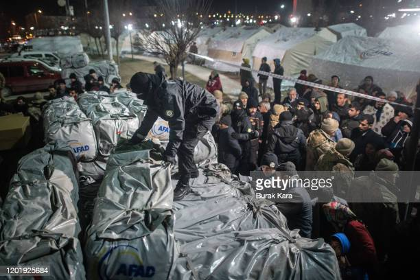 Earthquake survivors wait to receive aid near makeshift tents in a park on January 25 2020 in Elazig Turkey The 68magnitude earthquake injured more...